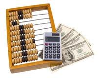 Vieux abaque, calculatrice et dollars d'États-Unis en bois Photos stock