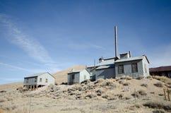 Vieux bâtiment de mine en ville fantôme Photos stock