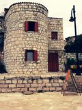 Vieux bâtiment en pierre arrondi photos stock