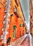Vieux bâtiments aux figures Photos stock