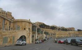 Vieux bâtiments et Victoria Cate dans le port grand de La Valette Photographie stock libre de droits