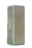 Vieux bloc utilisé d'amortisseur de clou d'isolement sur le fond blanc Photos stock
