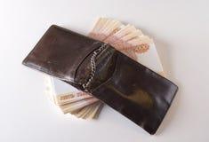 Vieux bourse et argent Photos stock