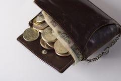 Vieux bourse et argent Photos libres de droits