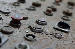 Vieux boutons de panneau de commande d'usine Image libre de droits