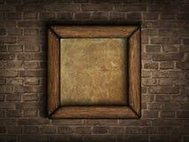 Vieux cadre sur un mur de briques Image libre de droits
