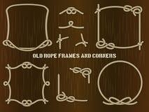Vieux cadres et coins de corde sur le fond de Brown Images stock