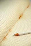 Vieux cahier avec le crayon Photos libres de droits