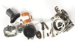 Vieux carburateur du démontage de pièce de moto Photographie stock libre de droits