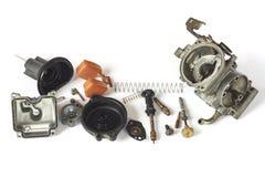 Vieux carburateur du démontage de pièce de moto Image libre de droits