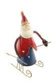 Vieux chiffre de Santa Claus en métal de vintage sur un traîneau Photos libres de droits