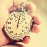Vieux chronomètre sur le fond blanc images stock