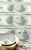 Vieux compas avec le curerrency d'USD Image libre de droits