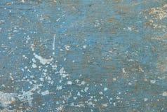 Vieux conseil en bois peint dans bleu-clair, avec les taches blanches aléatoires Photo libre de droits