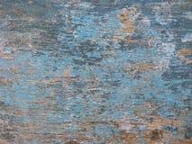 Vieux conseil en bois peint dans le bleu, avec des fissures et des taches Photographie stock