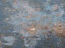 Vieux conseil en bois peint dans le bleu, avec des fissures et des taches Images libres de droits