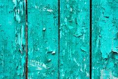 Vieux conseils avec la peinture cyan criquée Vieux fond en bois texturisé avec les lignes verticales Planches en bois étroites po images libres de droits
