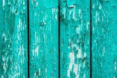 Vieux conseils avec la peinture cyan criquée Vieux fond en bois texturisé avec les lignes verticales Planches en bois étroites po images stock