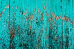 Vieux conseils avec la peinture cyan criquée Vieux fond en bois texturisé avec les lignes verticales Planches en bois étroites po image libre de droits