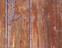Vieux conseils en bois avec des traces des peintures brunes là-dessus Photos stock