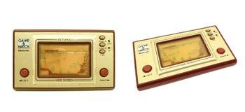 Vieux console de jeu, jeu de Nintendo et isolat portatifs de poulpe de montre Image libre de droits