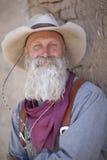 Vieux cowboy avec le chapeau et la barbe Photographie stock libre de droits