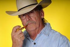 Vieux cowboy et pipe Photo stock