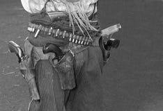 Armes à feu et étui sauvages de cowboy de hors-la-loi d'ouest Images libres de droits