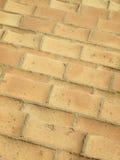 Vieux détail médiéval de modèle de trottoir de brique Image stock
