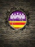 Vieux drapeau d'Îles Baléares dans le mur de briques Photo libre de droits