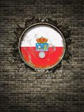 Vieux drapeau de la Cantabrie dans le mur de briques Images stock