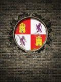 Vieux drapeau de la Castille Léon dans le mur de briques Photo libre de droits