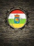 Vieux drapeau de La Rioja dans le mur de briques Image libre de droits
