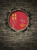 Vieux drapeau de Murcie dans le mur de briques Photo stock