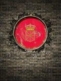 Vieux drapeau de Navarra dans le mur de briques Photos stock