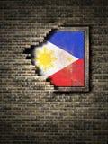 Vieux drapeau de Philippines dans le mur de briques illustration stock
