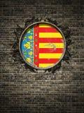 Vieux drapeau de Valence dans le mur de briques Images stock