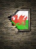Vieux drapeau du Pays de Galles dans le mur de briques illustration de vecteur
