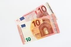 Vieux et nouveau billet de banque de l'euro dix Photos stock