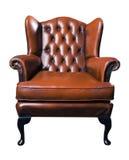 Vieux fauteuil en cuir sur un fond blanc Photos libres de droits