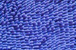 Vieux fond bleu de texture de tapis de plan rapproché Photo stock