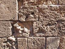 Vieux fond de mur en pierre de sable de mer Image libre de droits