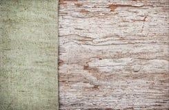 Vieux fond en bois avec la toile de jute de toile de jute Photographie stock libre de droits