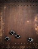 Vieux fond en métal avec des trous de balle Photographie stock libre de droits