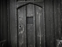 Vieux fond gothique fantasmagorique de porte - image courante Image stock