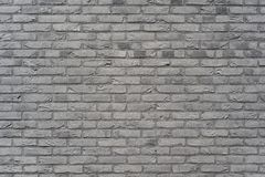 Vieux fond gris-foncé de mur de briques photo stock