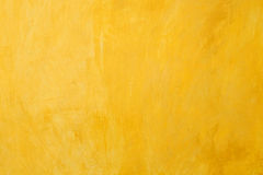 Vieux fond jaune de mur Images libres de droits