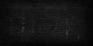 Vieux fond noir criqué de mur de briques photos stock