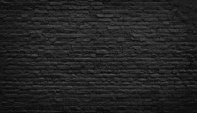 Vieux fond noir de mur de briques images stock
