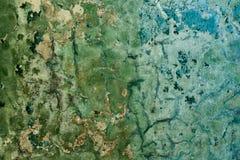 Vieux fond peint criqué diminué de mur photos stock